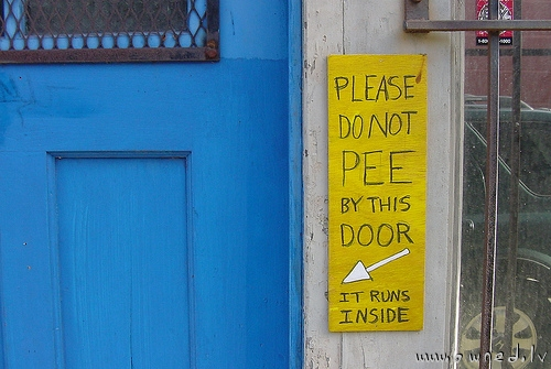 Please do not pee by this door
