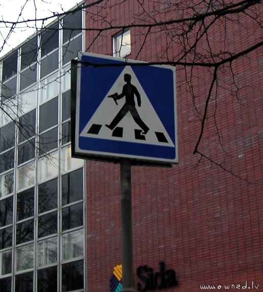 Road crossing with uzi sign